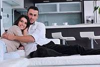 happy young couple relax at modern home living room indoor