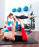 Aerobics woman personal trainer of children girl stability balance