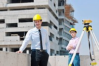 Team of architects people in group on construciton site check documents and business workflow