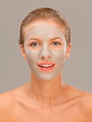beautiful woman with mud mask on face