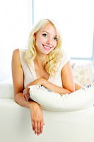 Smiling woman leaning on couch