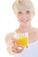 happy Young blonde woman drinking orange juice isolated over white background