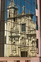 REFLECTION OF  PARROQUIA DE SAN JORGE CHURCH IN GLASS WINDOWS OF MODERN BUILDING LA CORUNA GALICIA SPAIN