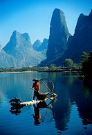 Li River, Guangxi, China: Young cormorant fisherman on river near Xingping Guilin area.