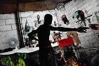 A Cuban man prepares the Palo religious ritual in the home temple in Santiago de Cuba, Cuba, August 1, 2009  The Palo religion Las Reglas de Congo bel...