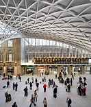 King´s Cross Station, London, United Kingdom. Architect: John McAslan & Partners, 2012. View of people waiting on the concourse.