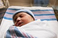 Sleeping Caucasian newborn baby boy