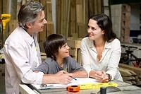 Hispanic family in carpentry workshop
