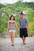 USA, Texas, Leakey, Young couple walking on gravel