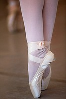 The feet of a ballerina on her toes
