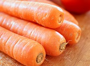 Pile of carrots on a chopping board