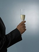 Business man holding champagne glass