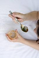 Little girl tasting honey
