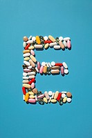 Multi_vitamin pills and capsules forming the letter E