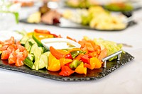 Catering table buffet vegetable salad plate