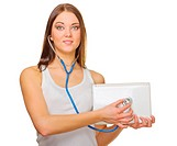 Young smiling girl with laptop and stethoscope isolated