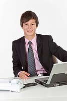 Young man sitting at a laptop
