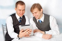 Young businessmen looking at clipboard computer