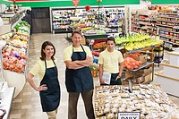 Workers in produce section of grocery store