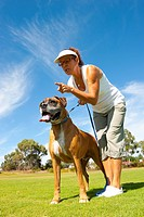 Woman with boxer bull dog