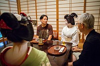 Fukuyu,geisha and Fukukimi,´maiko´ geisha apprentice workimg in Miyaki tea house o-chaia Geisha´s distric of Miyagawacho Kyoto  Kansai, Japan