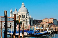Campo della Salute church with Venetian Gondolas in the foreground