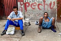 A drunk Colombian garbage recollector sleeping on the street in the slum of Calvario, Cali, Colombia, 23 April 2004  El Calvario is a slum in the pure...