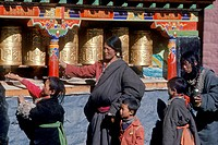 Pilgrims spin prayer wheels at Sakya Monastery _ Sakya, Tibet.