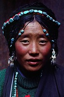Tibetan beauty with elaborate tourquoise headdress _ Barkhor,Lhasa.