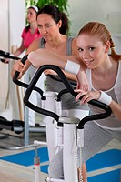 Young women using exercise equipment