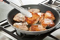 Browning Chicken in a Skillet, Flipping with Tongs