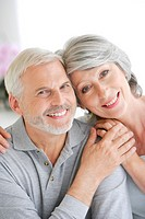 Portrait of senior couple smiling.