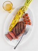 Grilled New York Strip Steak with Grilled Corn on the Cob and Tomatoes on the Vine, Glass of Beer