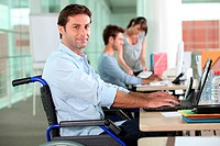 employee in wheelchair with laptop