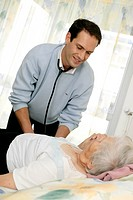 General practitioner examining an elderly person during a visit in a retirement home.