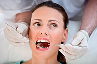 Woman getting dental examination at the dentist.
