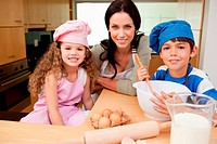 Mother and her children preparing cookies
