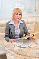 blonde woman at restaurant