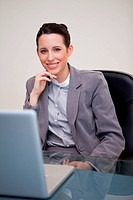 Smiling businesswoman sitting in her office