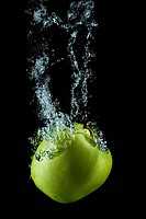 Golden apple splasing.