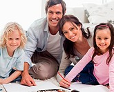 Smiling family drawing together