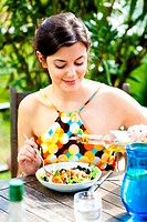Woman eating a mediterranean salad.