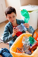 Boy sorting recycled wastes.