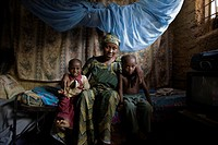 Kano, Nigeria: June 10, 2008. Mother and children with mosquito net in Kano, Nigeria. Sleeping under a long lasting insecticide treated net every nigh...