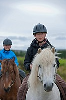 Children riding horses outdoors