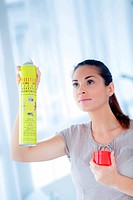 Woman using an insecticide in spray.