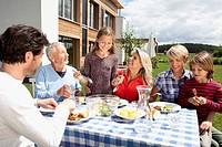 Germany, Bavaria, Nuremberg, Family barbecue in garden