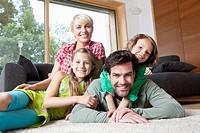 Germany, Bavaria, Nuremberg, Portrait of family in living room