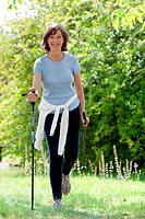 Woman practicing nordic walking.