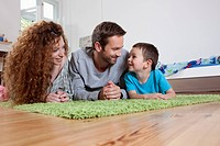 Germany, Berlin, Family on floor, smiling (thumbnail)